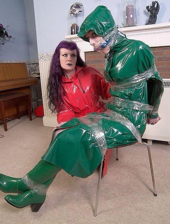 bondage girl Rainwear