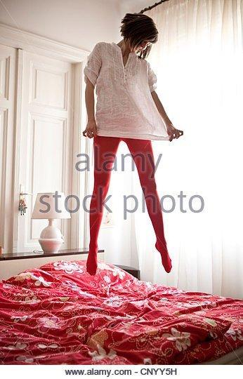 Jumping on bed pantyhose