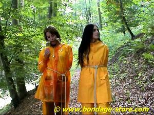 bondage girl Rainwear