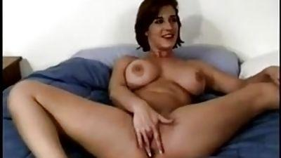 Naked girl inserting a tampon