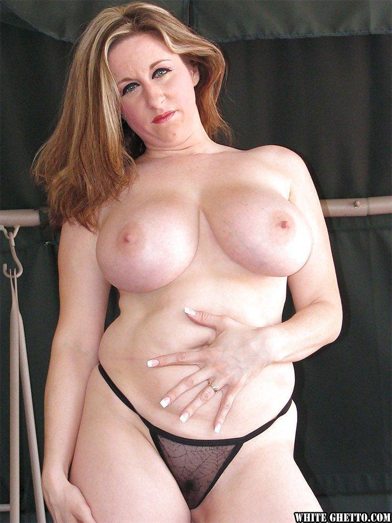 Busty business milf handjob
